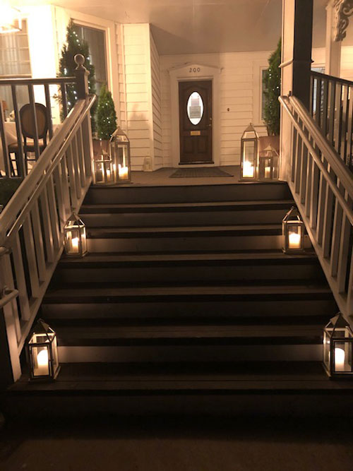 Whispers Restaurant is now open for dining on our porch as of June 23rd 2020. Here is a view of our beautiful Spring Lake, New Jersey porch at night